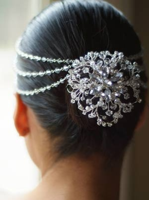 Adorned charm on a simple bun.