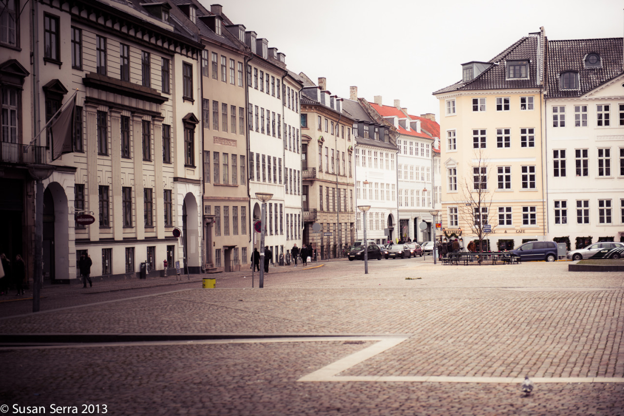 A beautiful square in Copenhagen. Classic mixture of white, cream, warm beige building facades. January 2013