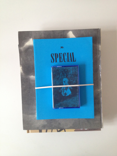 Mr. Special on top of book pile. You can also have it on top of your pile by purchasing it here: http://meau.bandcamp.com/album/mr-special