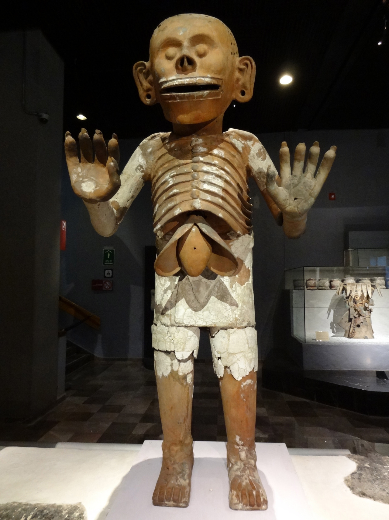 ancientart:  Aztec sculpture of Mictlantecuhtli. Artifact description via the Field Museum:  This statue depicts Mictlantecuhtli's liver falling from his chest; the Aztecs believed that a person's liver housed his passion, much like today's society associates the heart with passion. The holes in Mictlantecuhtli's head would have been filled with curly hair, which represented chaos to the Aztecs.  Courtesy & currently located at Templo Mayor, Mexico. Photo taken by feanor0