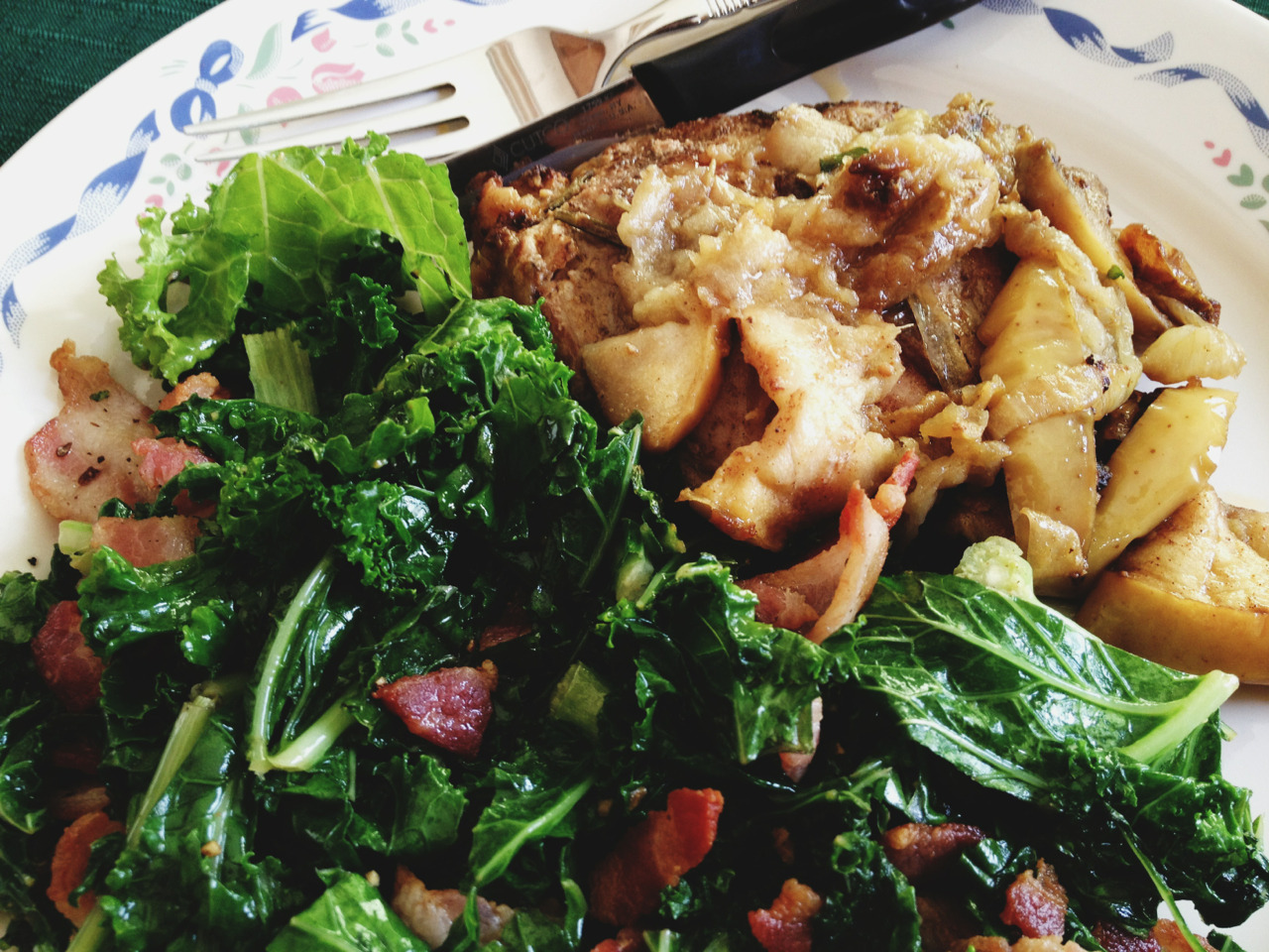 warm kale salad with leftover rosemary mustard pork chop + caramelized apple and onion