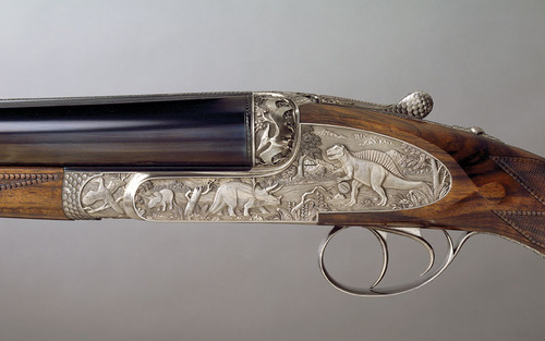 thesportinggunblog:  razvedchik:  BEST ENGRAVINGS EVER  There are a few gun makers who have made guns with dinosaur engraving. Usually custom work on special request, I'm not aware of any production run gun with such engraving.