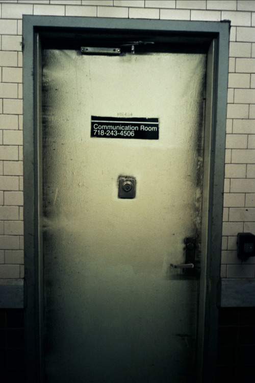 Menacing MTA door. THE COMMUNICATION ROOM.   I've taken to carrying around a small 35mm point & shoot. I'm looking at things more. The MTA system is full of odd corners, gates, and doors.