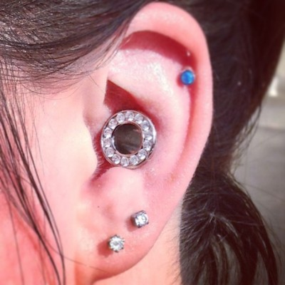 richardeffinivey:  Healed 00g conch at 8 months with a flawless #ANATOMETAL gemmed eyelet with hand set CZs.  #mybodymod #piercings #piercing #conch  How the fuck do you hear?!