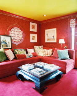 "The sumptuous ""red room"" in Ruthie Sommers' LA home, in which the designer covered the walls in a Rogers & Goffigon tone-on-tone fabric."