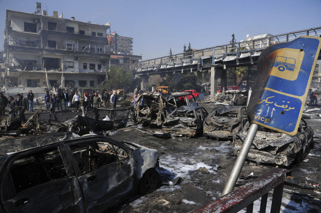 "A car bomb killed 53 people and wounded 200 in central Damascus on Thursday when it blew up on a busy highway close to ruling Baath Party offices and the Russian Embassy, Syrian television said. TV footage showed charred and bloodied bodies strewn across the street after the blast, which state media said was the result of a suicide bombing by ""terrorists"" battling President Bashar al-Assad. Central Damascus has been relatively insulated from almost two years of unrest and civil war in which around 70,000 people have been killed across the country, but the bloodshed has shattered suburbs around the capital. Rebels who control districts to the south and east of Damascus have attacked Assad's power base for nearly a month and struck with devastating bombs over the last year. READ ON: Car bomb kills 53 near Damascus ruling party building"