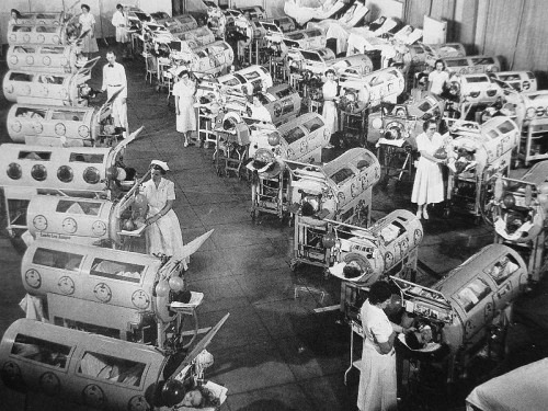 theniftyfifties:  Polio patients in iron lungs, 1952.