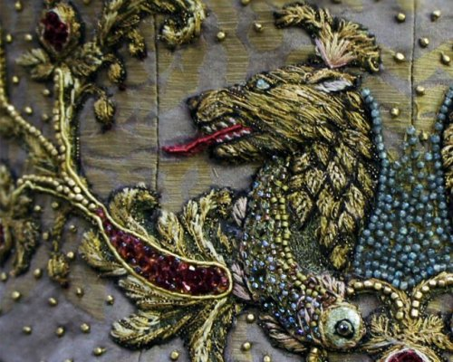 grimsperation:  Michele Caragher  Embroidered details in Game of Thrones  'Michele Carragher is a London-based Hand Embroiderer and Illustrator who has been working in costume on film and television productions for over 15 years. She studied Fashion Design at The London College of Fashion, where the course incorporated design, pattern cutting, garment construction, embroidery, millinery and illustration. At the same time she attended a three year evening course in Saddlery at Cordwainers College learning skills in leatherwork. After leaving college Michele worked in Textile Conservation, repairing and restoring historical textiles for private collectors and museums, specialising in hand embroidery. She then moved into a career in costume for film and television, initially working as a Costume Assistant/Maker on productions such as the BBC's Our Mutual Friend, ITV's David Copperfield and Mansfield Park. She soon gravitated towards the decoration and embellishment of costumes, using skills in hand embroidery and surface decoration, taking inspiration from the many historical textiles she had encountered working as a Textile Conservator.  The first production that saw her undertake the role of a Principal Costume Embroiderer was for HBO's 2005 Emmy Costume award-winning production of Elizabeth 1. Her most recent work has been on HBO's 2012 Costume award-winning television series Game of Thrones, working on all three seasons. As a Costume Embroiderer Michele specialises in hand embroidery and surface embellishment, using traditional hand embroidery techniques, smocking, beading and surface decoration. She works directly onto the completed garment or starts with motifs and textures on silk crepeline/organza, which are applied to the costume and then worked into once on the actual garment. She also works on existing machine embroidery designs that are not too dense, adding some hand stitching and beading to give a more authentic, hand-finished look. Michele finds hand embroidery has more flexibility and diversity than that of embroidery created by machine, as there is a greater variety of thread choice and colours to use. It is also possible to work more easily on garments that are already constructed. However, machine embroidery in combination with hand work can be very useful when completing many repeats by creating light outlines or a less dense machine stitch, work can then be completed by hand and again can be carried out on a finished garment. Michele is a highly creative Costume Embroiderer, producing original designs as well as working closely to a costume designer's brief to create their desired look.' Text and images from  http://www.michelecarragherembroidery.com