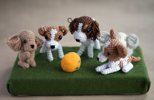 Annie's Granny Design made these little crocheted cuties.  She says that the patterns came from Mitsuki Hoshi in her books Ami Ami Dogs and Ami Ami Dogs 2.