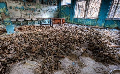 sacred-fox:  Two of the most haunting images of the Chernobyl Exclusion Zone.  Yes, that is a pile of gas masks in the second photo…