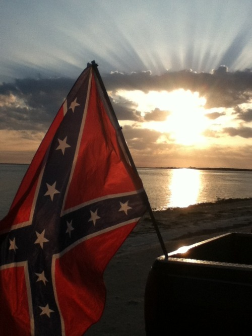 shallnotsurrender:  My best friend's flag and the beautiful sun today. Love you guys.