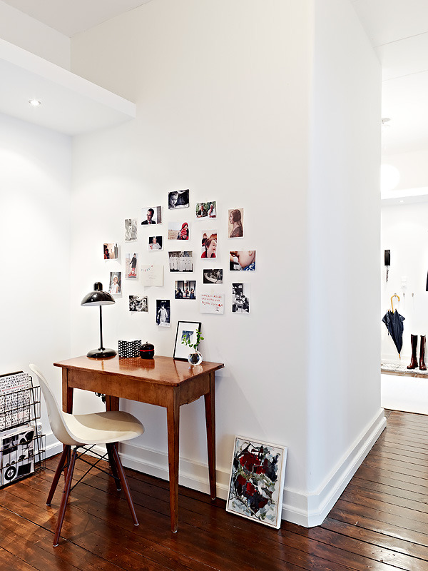 Even the pictures on the wall are setup in a minimal fashion with no distracting ornamental frames or anything.  Neat twist on the Herman Miller chair too.  Looks like they stained the legs to closer match the desk and flooring a bit.