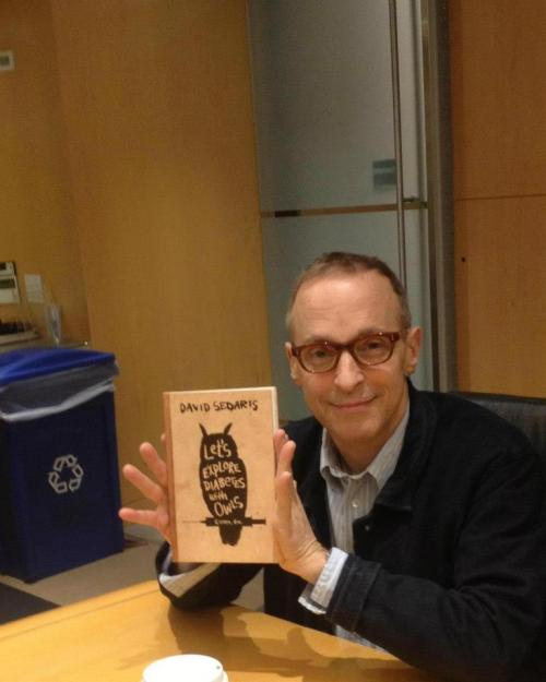 David Sedaris signing copies of his newest book at his publisher's office. (Source: Facebook)