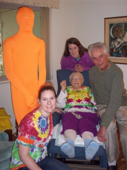 Orange Man Suit and Old Lady Makes For Strange Family Portrait But not as weird as tie-dye.