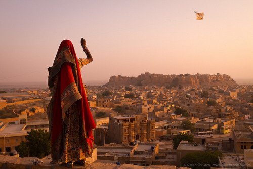 disconcertingly:  Girl With Kite, India by Simon Christen - iseemooi on Flickr.