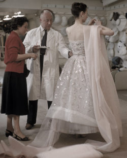 Christian Dior in his salon in 1957