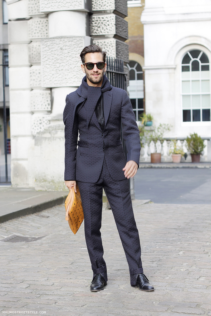 Matthew Zorpas in a black textured suit