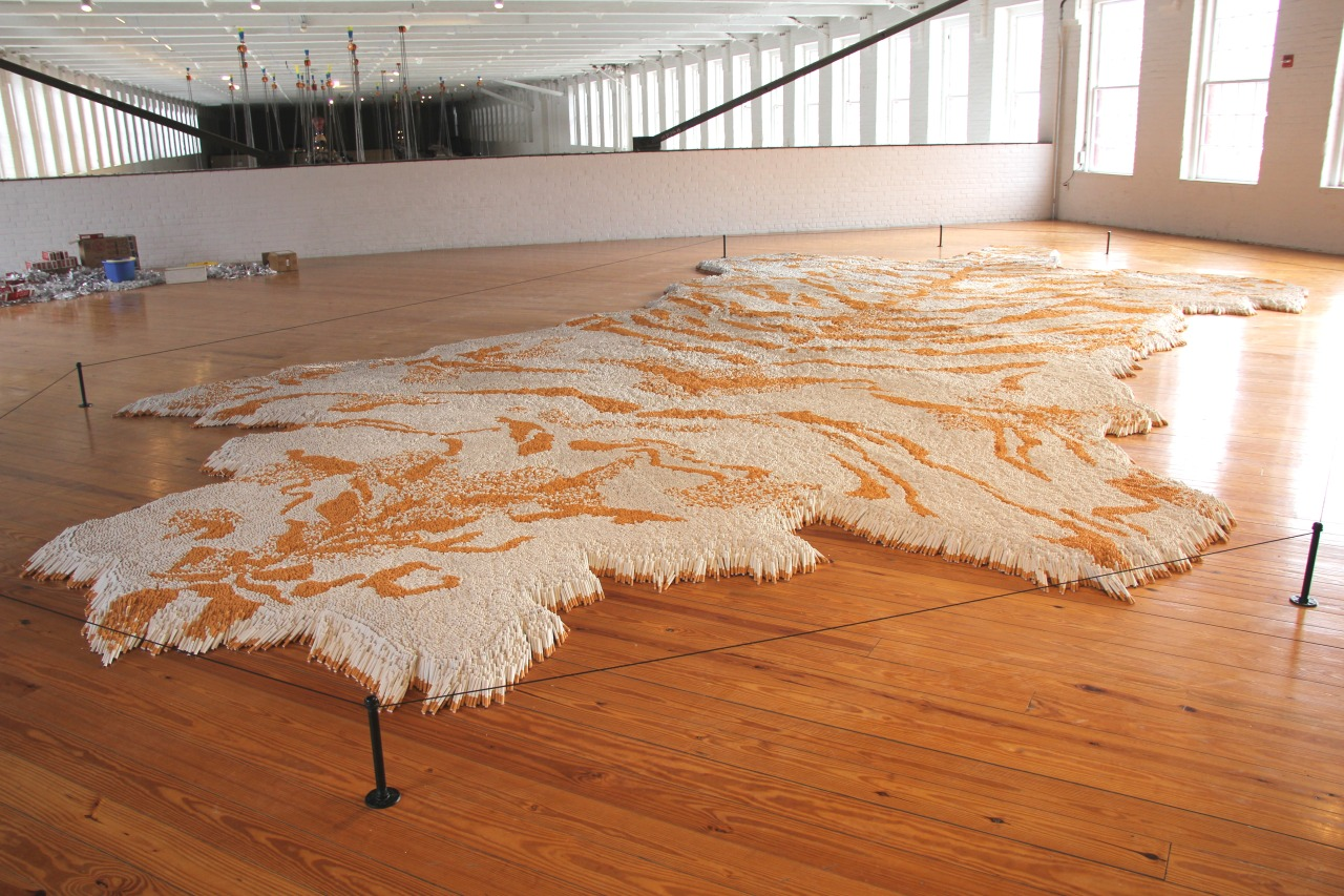 "massmoca:  It took half a million cigarettes to make Xu Bing's ""1st Class."" Check it out in the mezzanine of our Building 5 gallery.  Here I was thinking this was and OD rug, but I was mistaken….But can i get neighbor? they wont miss one.."