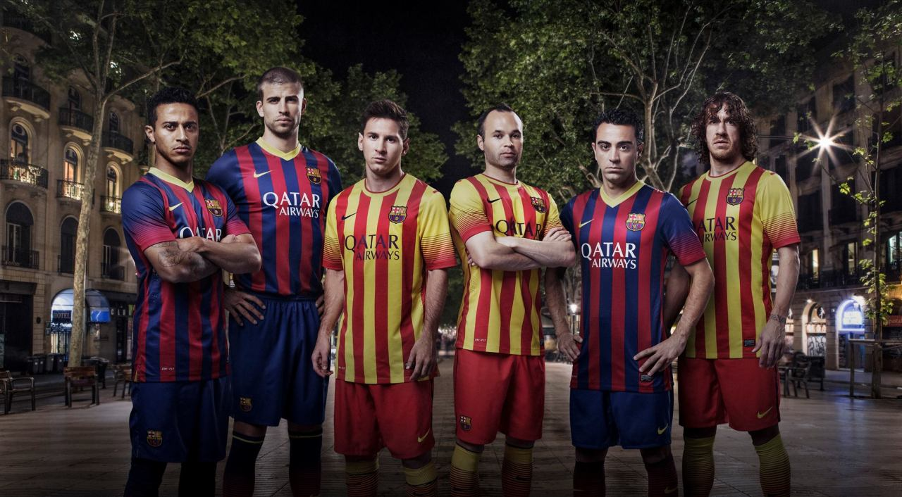 "PHOTO: FC Barcelona unveils new uniforms with Qatar Airways logo FC Barcelona has unveiled its new uniforms for the 2013/14 season, which for the first time will sport the Qatar Airways logo. Barca's tie-up with the national carrier is its first deal with a corporate sponsor, and part of a $230 million five-year deal with Qatar Sports Investments. The team previously wore the Qatar Foundation logo on its jerseys. Under the new agreement, FC Barcelona will get some $45 million a season in exchange for wearing the airline-branded jerseys until June 2016, an agreement that CEO Akbar Al Baker said will elevate the Qatar-based company's brand. Firsts Unicef will continue to be displayed on the back of the shirts. And though it will no longer appear on the jerseys, QF will remain the official ""human development"" partner. In more firsts, Barca has also reached a six-year deal with American sportswear firm Nike, for which they will get $18 million annually. And finally, for the first time, FC Barcelona will play in an away uniform featuring the red and yellow of the Catalan flag - the Senyera - as the club's traditional stripes.  Thoughts on the new jersey? Credit: Photo courtesy of Qatar Airways on Facebook"