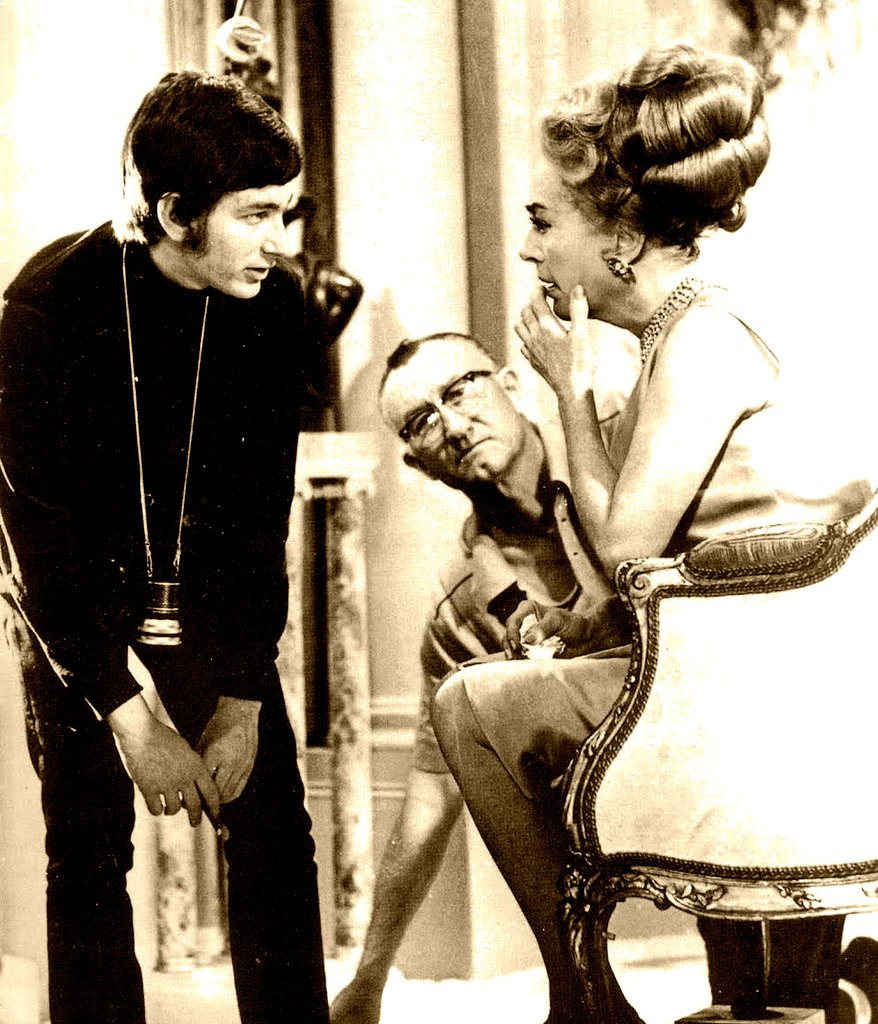 "Steven Spielberg & Joan Crawford    ""….Spielberg discussing a scene with Crawford in 1969's made for TV movie ""Night Gallery"" initially, Crawford was not happy to have a 21 year old director, but Spielberg's professionalism & skill, put to rest any skepticism Joan may have had….she closely followed Spielberg's career as a director until her death in 1977, a unique pairing of two different eras in film making…."" (source)"
