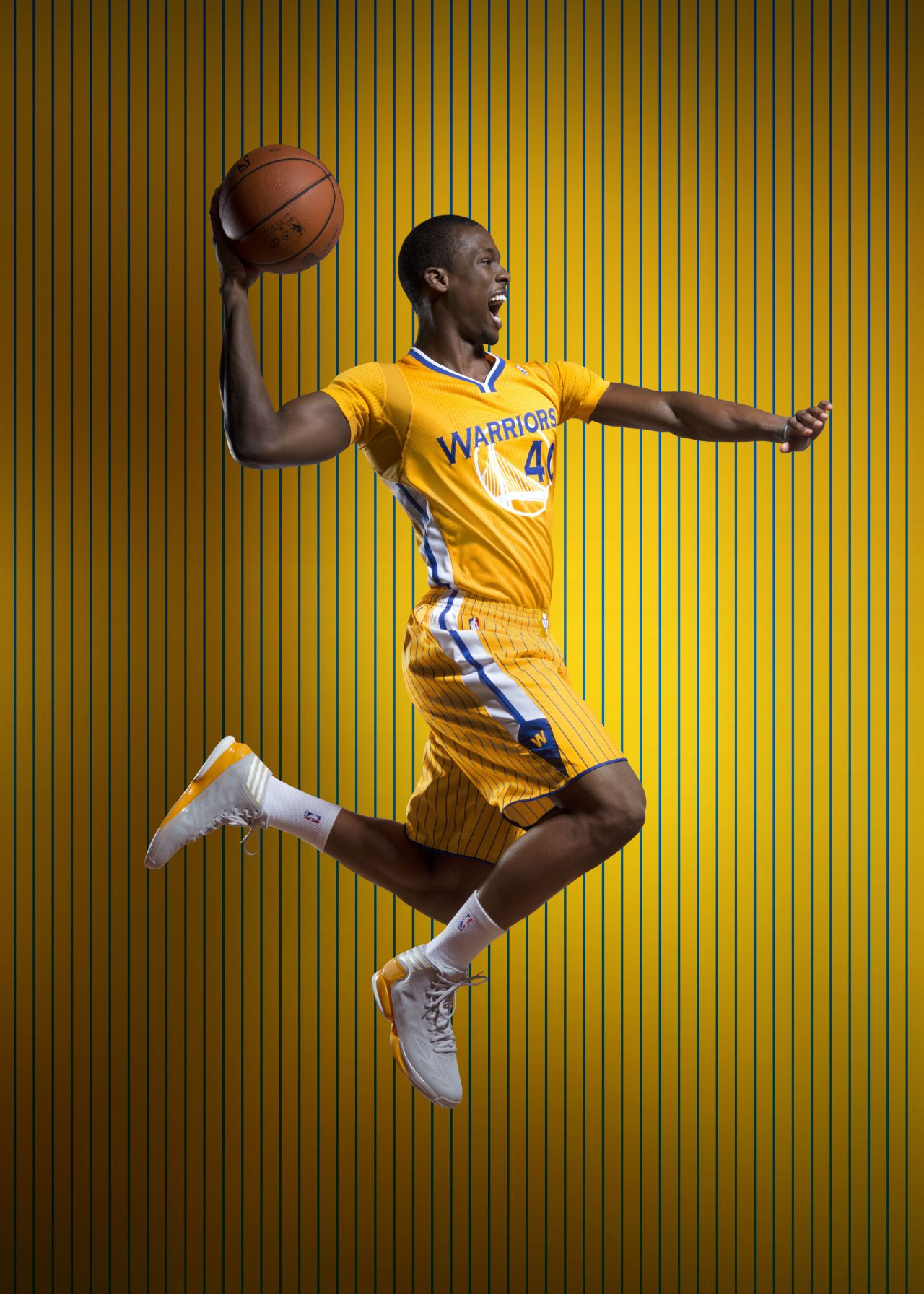 "Here's Harrison Barnes of the Golden State Warriors modeling the team's new alternate jersey - with sleeves! This is another questionable ambitious Adidas design, after this year's special Christmas uniforms. The material is supposed to be 25% lighter, but the combination of t-shirt top and pinstriped shorts gives the whole ensemble a real ""laundry day"" look. Perhaps this new uniform is designed to appeal to 2013 free agent Dwight Howard, who loves sleeves of all kinds, and might take the court with a full Spandex cat burglar outfit under his jersey by the end of the year. Or, it will be a nice transition for undershirt-loving college kids on their way to the NBA. Patrick Ewing would have loved this jersey, and the added sweat absorption might have changed the course of his entire career."