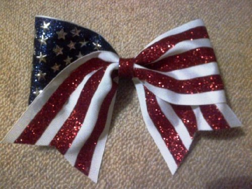 tailgatebeauty:  my two loves in one….want this bow <3
