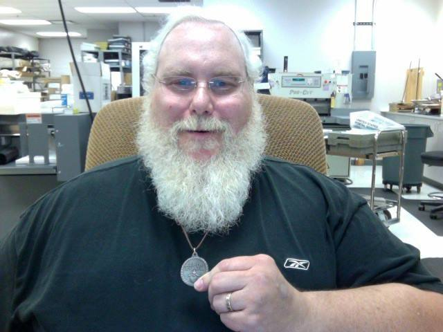 "Santa Russell Schurbon with his Beard Token converted into a necklace. Use the discount code, ""MIDMAY"" for 15% off when you checkout at http://beardtoken.com/  It expires with the weekend."