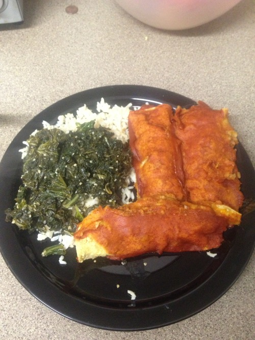 I'm proud of this meal because nothing really went wrong :) Its kale, basmati rice, and black bean and sweet potato enchiladas When i went to my moms house earlier this week she made sauteed sweet potatoes and I've been stuck on them. After having a conversation with a friend about black beans and sweet potatoes i decided i was going to make enchiladas when i got home.  I didn't really follow a recipe. I just threw things together. I sauteed sweet potatoes (which im proud of cuz i did it right. i made two potatoes earlier this week and burned them. the key was a lid on the pot) and i also sauteed onions, garlic, canned black beans and canned green chilis together. I made the enchilada sauce myself. I hate the way canned sauce tastes. This sauce doesnt really taste authentic but it tastes better than the stuff in the cans.  I'm also proud of this meal cuz my kale came out perfect. In the past when i made it it was never tender enough (the key is a lid on the pot lol). my enchiladas are a little sweeter than I wanted them to be (i put a little too much sweet potato in them) but theyre really good and im satisfied