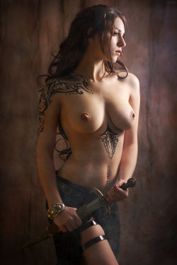 Nude woman with tribal markings and dirk. ~ trish    inspired by Royo by *gestiefeltekatze    ** Read TrishCausey's Blog! — now with more awesomeness! **