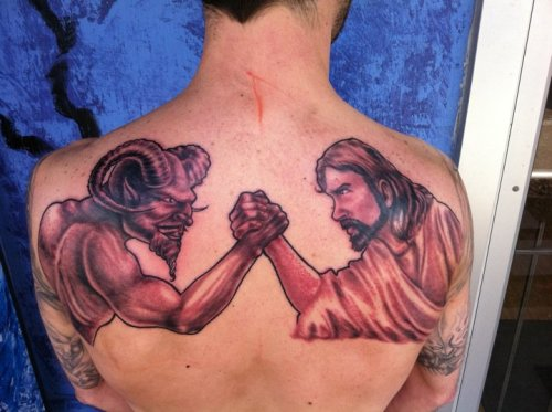 christiannightmares:   Jesus arm wrestles Satan in this sick back tattoo (Found at the blog of Matthew Paul Turner; For a related post, click here http://christiannightmares.tumblr.com/post/871398416/christian-tattoo-jesus-plays-bass-guitar-on-a)