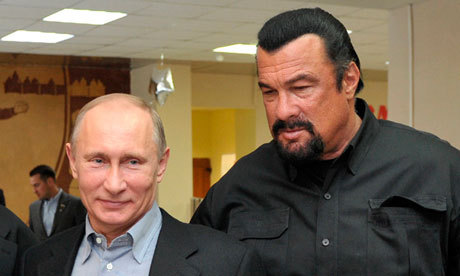 chrismohney:  guardian:  Vladimir Putin and Steven Seagal at a martial arts school on the outskirts of Moscow, to promote healthy lifestyles. The film star acted as the Russian president's bodyguard in what seemed like a choreographed move. Photograph: Alexei Nikolsky/AFP/Getty Images  soulmates  Putin with his Bond villan.