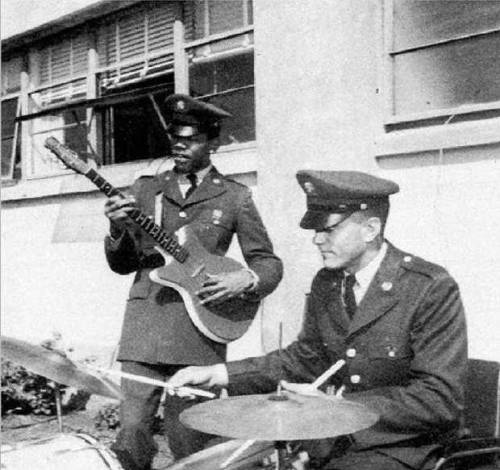 19-year-old Jimi Hendrix jamming with an army buddy, 1961.