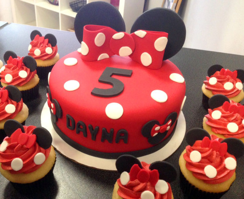 Minnie Mouse cake with matching cupcakes for a 5th birthday party!