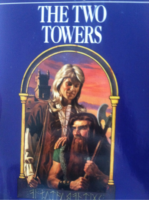 jareds-assalecki:  okay so my dad finally found his copy of the two towers and oh mY GOD IT LOOKS LIKE A ROMANCE NOVEL I CAN'T STOP LAUGHINFG WHENEVER I SEE IT LOO K AT LEGOLAS' MULLET CZKLANXNKSKAHX AND GIMLI'S JUST STARIUNG INTO THE DISTANCE  AH! GREENEKANGAROO, THIS IS IT! THIS IS THE COVER I WAS TELLING YOU ABOUT!