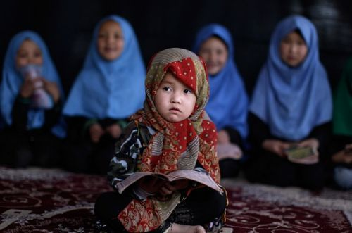 islamic-art-and-quotes:  Muslim Little Girls Studying From the Collection: Photos of Muslim Little Girls Wearing Hijab Originally found on: proudmuslimaa