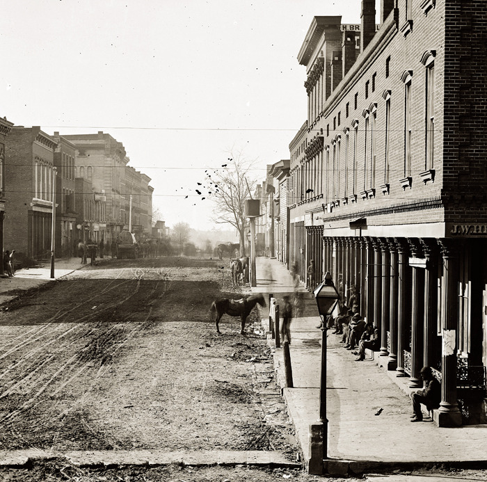 1864 view of Whitehall Street (now Peachtree) looking south from Alabama Street. View Larger Map