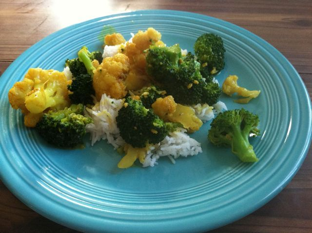 Saturday night's dinner: broccoli and cauliflower florets cooked with coconut milk, curry powder and garlic and served over basmati rice.