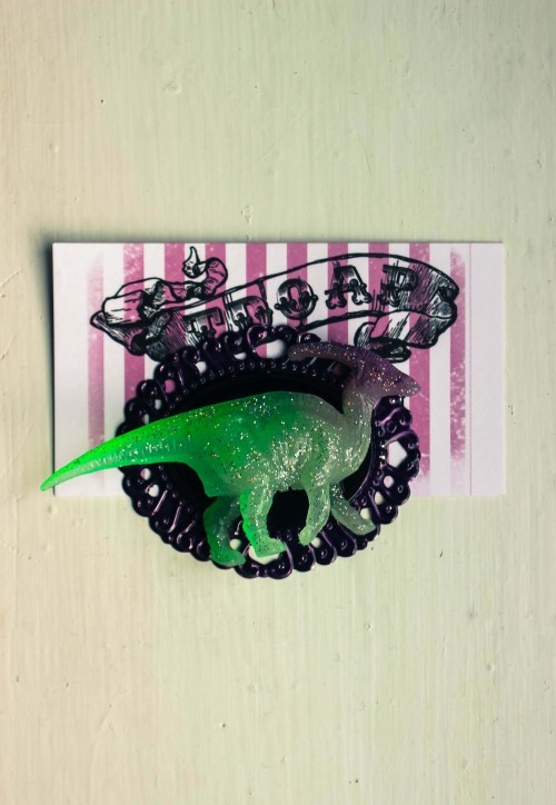 Glow in the dark, holographic glitter dinosaur brooch at TDOAP