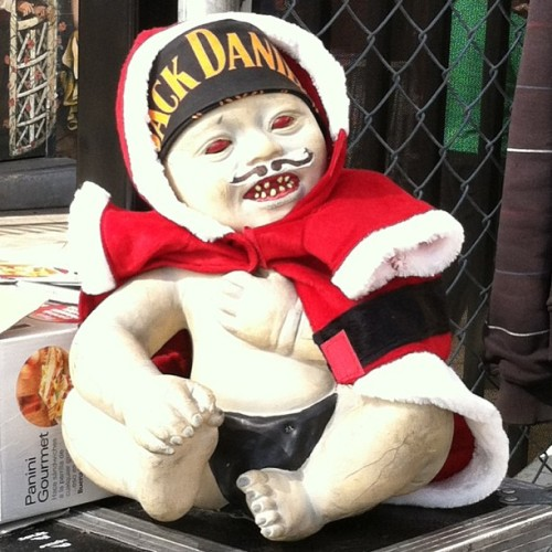 Saw this #bad #boy on my #way to #work. #jack #daniels #santa #baby #mustache #red #creep #scary #laugh #smile