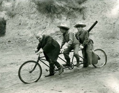 ridesabike:  Curly Howard, Larry Fine and Moe Howard ride a bike.  The Tri-Stooges