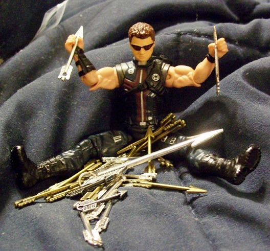 mollyhooper-barton:  Uh-oh. Clint has stumbled upon my stash of arrow charms. I think he's happy.  Gosh…I love arrows