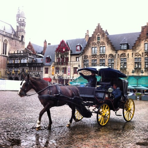 The picturesque Brugge/Bruges. Horse carriages everywhere (at Markt)