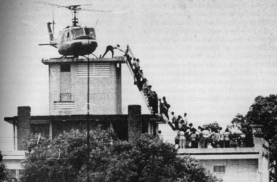 """April 30, 1975 - In the early hours of the 30th, the last helicopter to evacuate US officials and some South Vietnamese allies pulled out, and not too longer after, Saigon fell to the Vietcong. So as we remember the US soldiers and the war that the US didn't win, let's not forget the Vietnamese refugees, the Hmong who were abandoned despite their assistance to the CIA, the rise of the Khmer Rouge because of the US bombings in Cambodia and its aftermath, etc. The Vietnam War has a huge grip on the American conscience, and what we learn in textbooks that does not do justice to the million of lives who have been impacted by war, both here and abroad.This picture by Hubert Van Es captures a helicopter on an apartment building rooftop in downtown Saigon where CIA employees were housed. Though the setting has been mistaken to be the US Embassy in South Vietnam, it essentially gives the sense of desperation that was rampant among the South Vietnamese this time 38 years ago."""