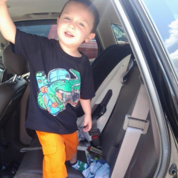 Christian rocking his new clothes. #dinosaur #shirt #orange #shorts #mylittleman #coolkid
