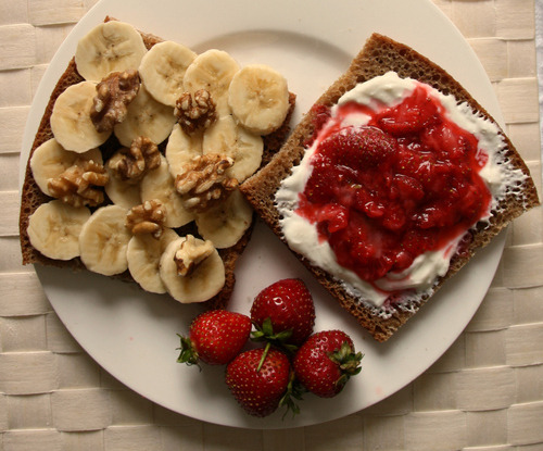 yummy toast with banana and strawberry jam