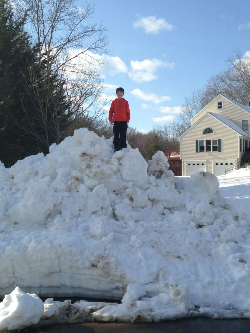 NEWS 8 Report It Photo of the Day: A boy stands atop a large snow bank after their road was finally plowed out in Guilford, Conn. following the Blizzard of 2013. Photo sent in via Report It by Scott Markovich.