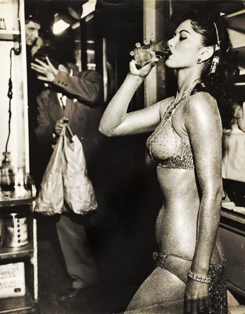 "vintagegal:  ""The Gold Painted Stripper"" photograph by Arthur ""Weegee"" Fellig, 1950"