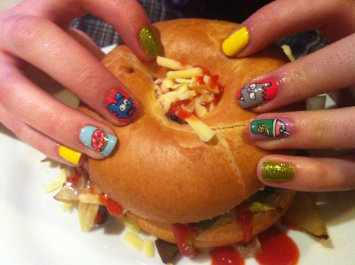 "nailburgerlar:  ""Simpsons mani painted by myself (nancymcnails) for leannecnails, my trusty side kick! Using a combo of Models own, Barry M and Topshop polishes, finished with the only topcoat that should ever be used, Seche Vite!   We present to you the almighty DIY Vegan Burger Bagel! Stuffed with onions, avocado, mushrooms, grated soya cheese and ketchup! A solid 8 for joint cooking efforts and the happy food comas that followed!"" Thanks Nancy! I haven't done a meat-free monday post in quite a while. Check out these two ladies' blogs for great nail art if you haven't already nailburgerlars!"