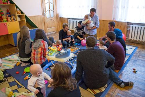 Taking a break from a leadership development meeting, Peace Corps Volunteers in Ukraine visited an orphanage to spend a few hours playing with infants, along with host country counterparts. About 55 children live at the orphanage, ranging in age from newborn to 3 years. The Volunteers also donated coloring books, markers, and diapers to the orphanage.