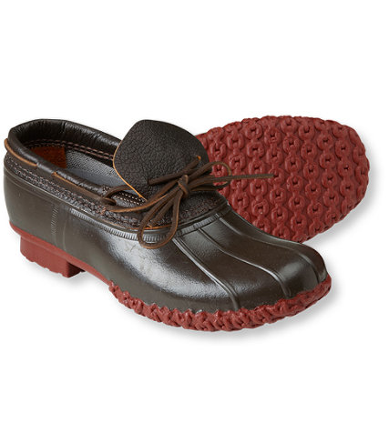 "L.L.Bean bison leather rubber mocc — I picked up ""The Official Preppy Handbook"" a while back and was rather amused at seeing a list of official ""preppy"" shoes. The L.L.Bean mocc was among them, but I've always found its look quite weird.  This new mocc though is pretty cool looking. I like the darker tone of the bison leather and the red rubber chain tread sole (apparently, L.L.Bean found this color in their early archives) really sets off the shoe in a different way.  It still has all the typical good stuff you'll find from L.L.Bean's boots: made in Maine, waterproof and weird sizing. It can be yours for $94."
